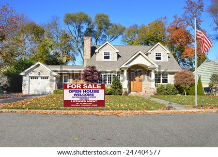 Real estate for sale open house welcome sign beautiful suburban cape cod style home autumn clear blue sky day residential neighborhood USA - stock photo