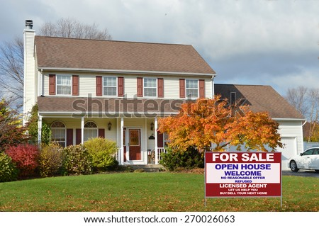 Real estate for sale open house welcome sign Beautiful Suburban McMansion Home autumn day overcast cloudy sky residential neighborhood USA - stock photo