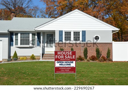 Real Estate For Sale Open House Welcome sign on front yard lawn of suburban home fall day residential neighborhood USA Blue Sky - stock photo