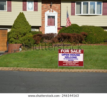 Real estate for sale open house welcome sign Suburban High Ranch brick landscaped home with cobble stone curb sunny autumn day residential neighborhood USA - stock photo