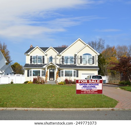 Real estate for sale open house welcome sign Suburban McMansion home autumn day blue sky residential neighborhood USA - stock photo