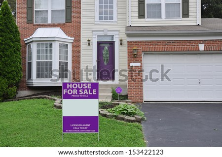 Real Estate House For Sale Sign on front yard lawn of Suburban Home Residential Neighborhood USA - stock photo