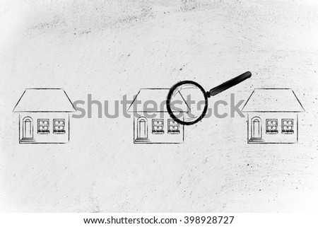 real estate market and house hunting: magnifying glass analyzing a group of houses - stock photo