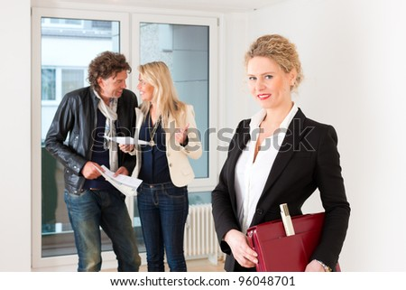 Real estate market - young couple looking for real estate to rent or buy - stock photo