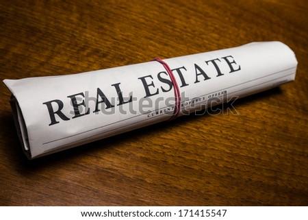 real estate newspaper on desk - stock photo