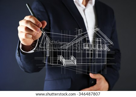 Real estate offer. Businessman drawing a model of the house - stock photo