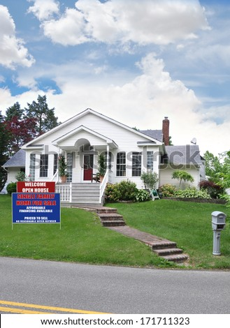 Real Estate open house for sale sign front yard landscaped lawn suburban home residential neighborhood USA blue sky clouds - stock photo