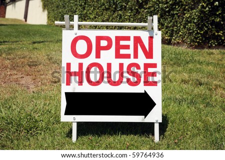 Real estate open house sign in a yard - stock photo