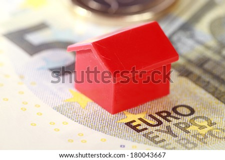 Real estate replica houses on euro banknotes - stock photo