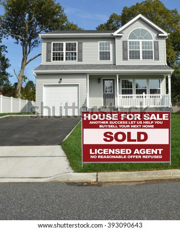 Real estate sold (another success let us help you buy sell your next home) sign Suburban McMansion House Residential Neighborhood USA - stock photo