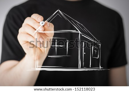 real estate, technology and accomodation - picture of man drawing a house on virtual screen - stock photo