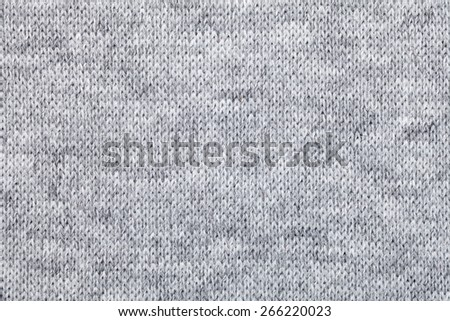 Real grey knitted fabric made of heathered yarn textured background - stock photo