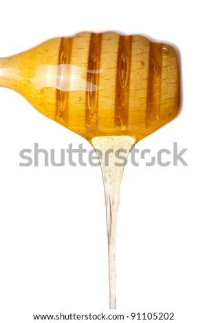 Real honey stick  isolated on white - stock photo