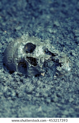 Real human skull figured as real crime scene, color manipulated, narrow focus - stock photo