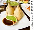 real indian samosa shot in indian restaurant - stock photo