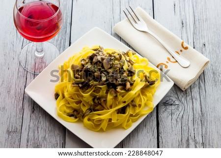 Real Italian Tagliatelle with mushrooms  - stock photo