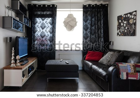 Real life tv room with sofa and entertainment center - stock photo