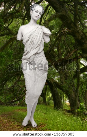 """Real Live Statue of """"Aphrodite of Milos"""" in a Green Wooded Area - stock photo"""