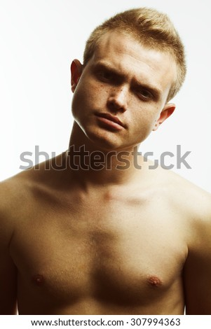 Real natural male beauty concept. Close up portrait of handsome charismatic young man posing over white background. Trendy hipster haircut. Classic style photo. Fashion studio shot - stock photo