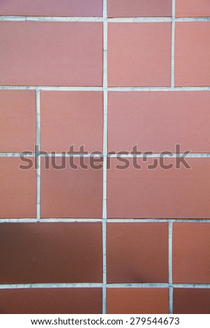 Real orange tile patern placed on the floor - stock photo