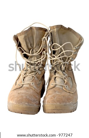 Real pair of U.S. Army boots that served in Iraq. You can still see the mud in the lower seams. Focus = front laces. - stock photo