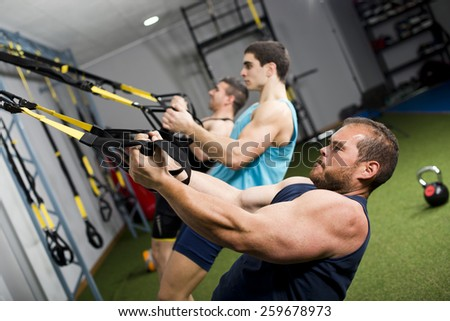 Real people training cross fit at gym center - stock photo
