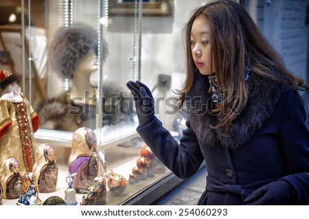 Real Photo Asian girl near funiture shop - stock photo