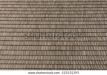 Real photo of wooden shingles on the roof - stock photo