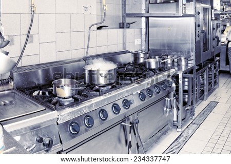 Real restaurant kitchen shot in operation, complex toned image - stock photo