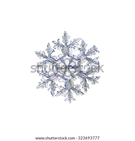 Real snowflake photo, bright variant, isolated on white background - stock photo
