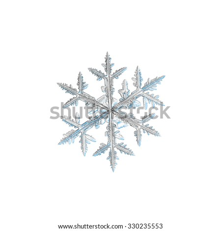 Real snowflake photo (medium size stellar dendrite crystal), isolated on white background - stock photo