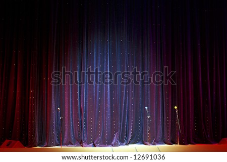 real stage curtain and microphones backdrop - stock photo