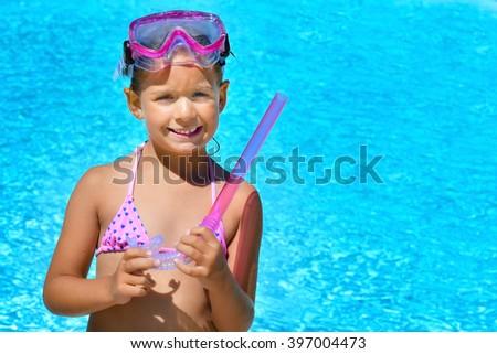 Real toddler girl enjoying her summer vacation at beach - stock photo