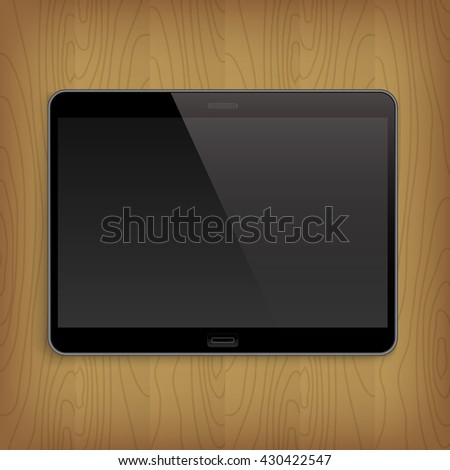 Realistic tablet with empty screen on wooden table. - stock photo