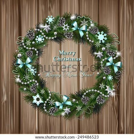 Realistic wreath of fir branches on wood background. Christmas and New Year design elements: snowflakes, branches, pine cones, ribbons, stars, garlands, beads - stock photo
