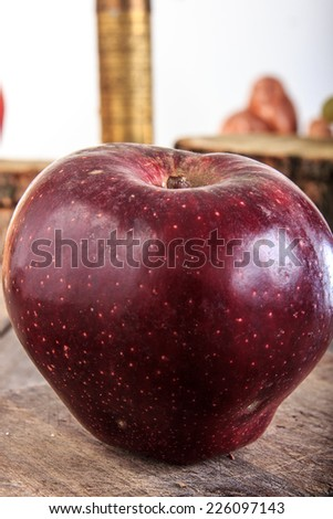Really red apple on gray old wooden table, retro vintage style - stock photo