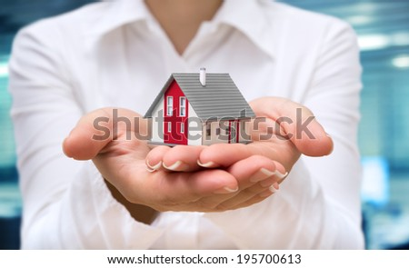 realtor deliver house - real estate concept  - stock photo