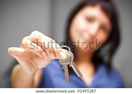 Realtor is giving the keys to an apartment to some clients. focus on the keys - stock photo