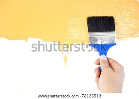Realy  painted shape with brush and hand  / white background / copy space - stock photo