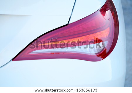 Rear light of a modern car - stock photo