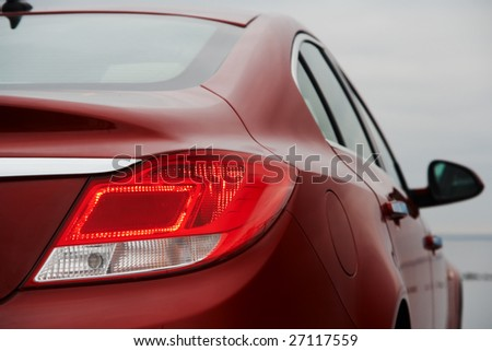 Rear light of red business car - stock photo