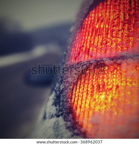 Rear lights of the car in winter - stock photo