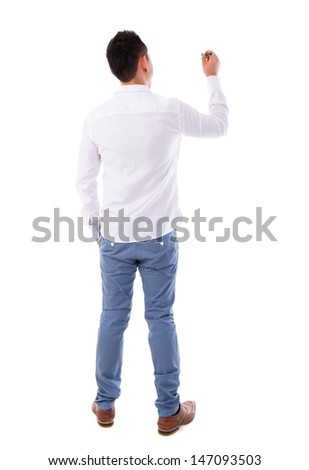 Rear or back view full body picture of an Asian male in white shirt writing something on glass board with marker - stock photo