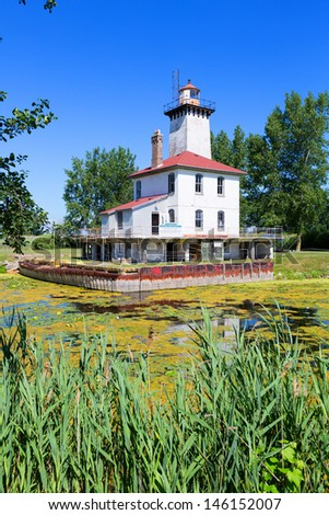 Rear Range Lighthouse on the Saginaw River helps guide ships to enter the mouth of the Saginaw River from Saginaw Bay. This lighthouse sits on private property and is rarely open to the public. - stock photo