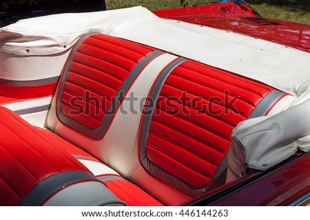 Rear seats in a red vintage car - stock photo
