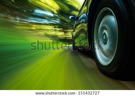 Rear side view of sport car with heavy blurred motion. - stock photo