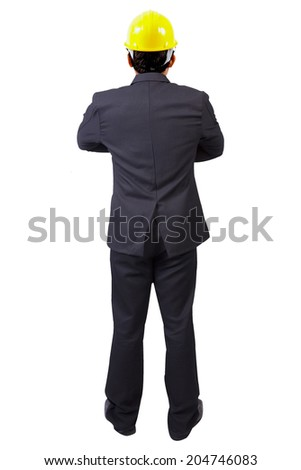 rear view businessman standing cross one's arm and yellow helmet for workers security in concept of real estate and engineering on white background with clipping path - stock photo