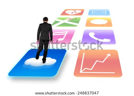 Rear view businessman surfing on shiny cloud app icons with white background - stock photo