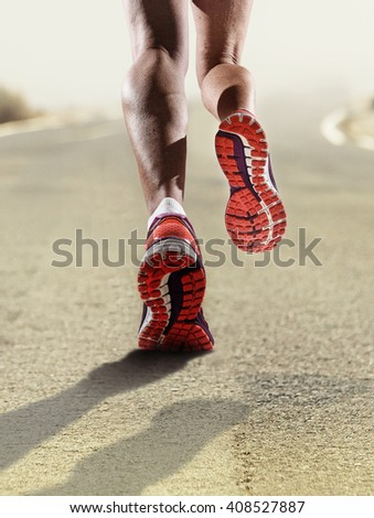 rear view close up strong athletic female legs and running shoes of sport woman jogging on asphalt road fitness healthy lifestyle high performance and endurance concept advertising style - stock photo