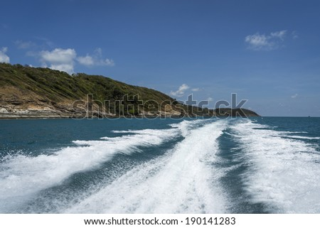rear view from speed boat, island - stock photo